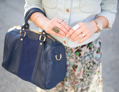 An Dyer wearing BCBGeneration Alexander The Jirt Chambray Denim Shirt, SoleSociety Kaylin Bag, Jewelmint Tangled Web & Alexandria Rings, Besobeso by Luka Candace Ring, TopShop Floral Maxi Skirt
